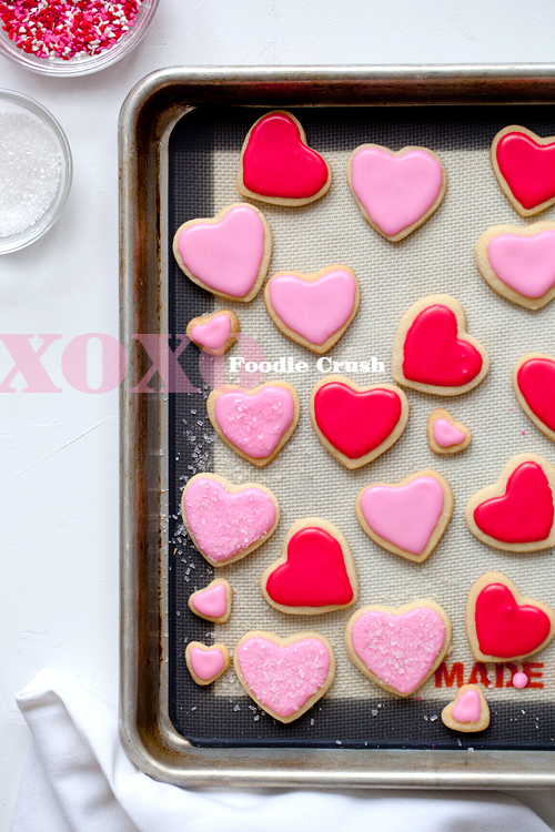 Heart shaped sugar cookies with pink frosting