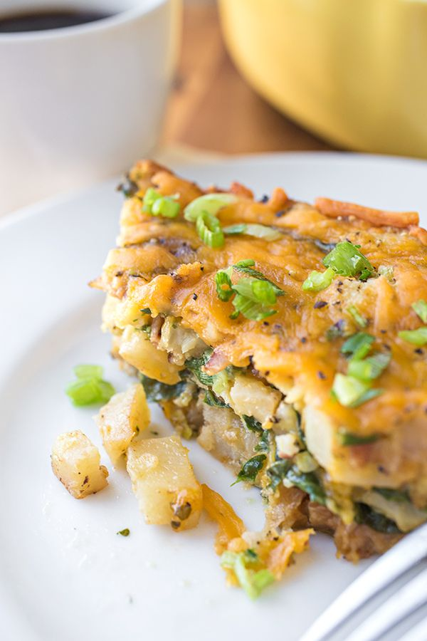Cheesy Breakfast Bake with Crispy Bacon, Spinach, Caramelized Onions and Diced Potatoes from thecozyapron.com on foodiecrush.com