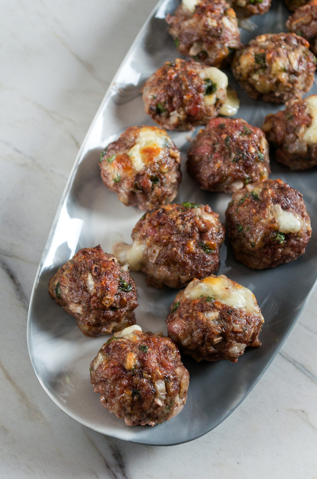 Cheese Stuffed Meatballs from Sprinkled Side Up on foodiecrush.com