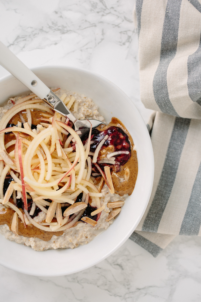 Almond Butter & Jelly Oatmeal Bowl with Spiralized Apples and Toasted Almonds from inspiralized.com on foodiecrush.com
