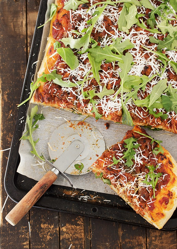 Pork Ragu Pizza Ricotta Salata With Arugula from Seasons & Suppers on foodiecrush.com