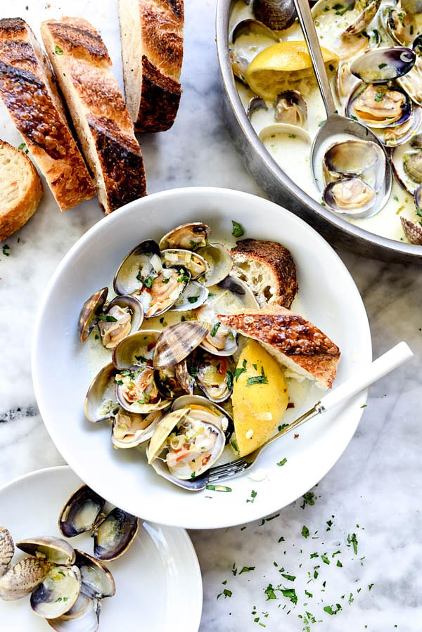 How to make the BEST steamed clams with wine and just a touch of cream | #easy #recipe #wine #butter #garlic foodiecrush.com