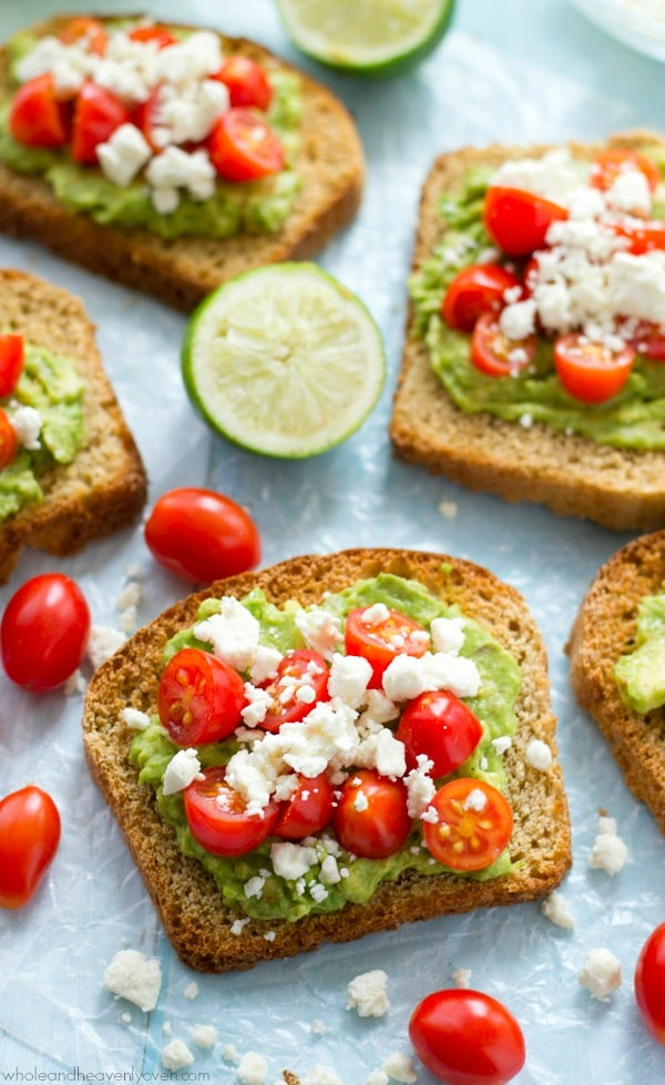 Greek Avocado Toast with Cherry Tomatoes from wholeandheavenlyoven.com on foodiecrush.com