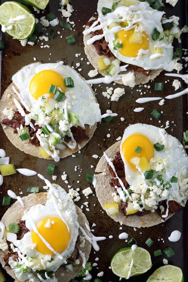 Breakfast BBQ Pork Tostadas with Cotija Ceese and Lime Crema from Wilde Flavors | foodiecrush.com