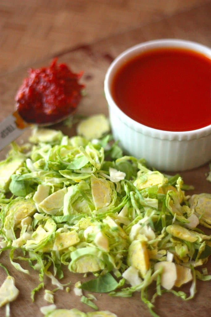 Raw Brussels Sprouts Salad with Harissa Vinaigrette by Project Domestication on foodiecrush.com