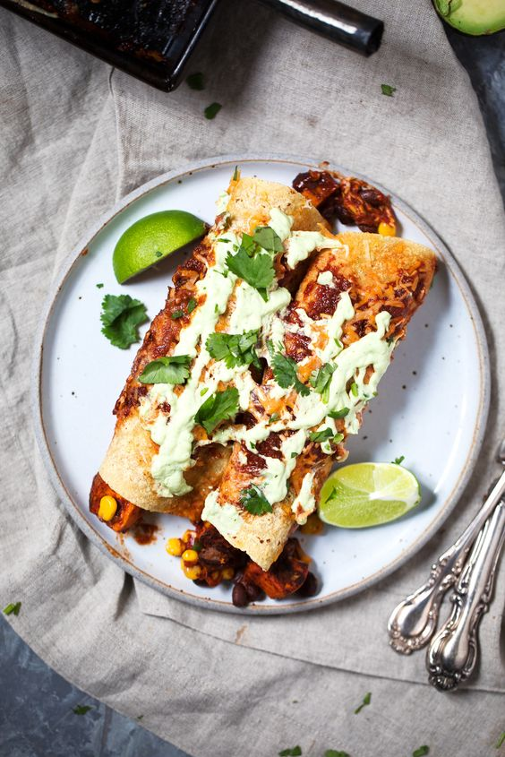 Sweet Potato Black Bean Enchiladas with Avocado Lime Crema from ambitiouskitchen.com on foodiecrush.com
