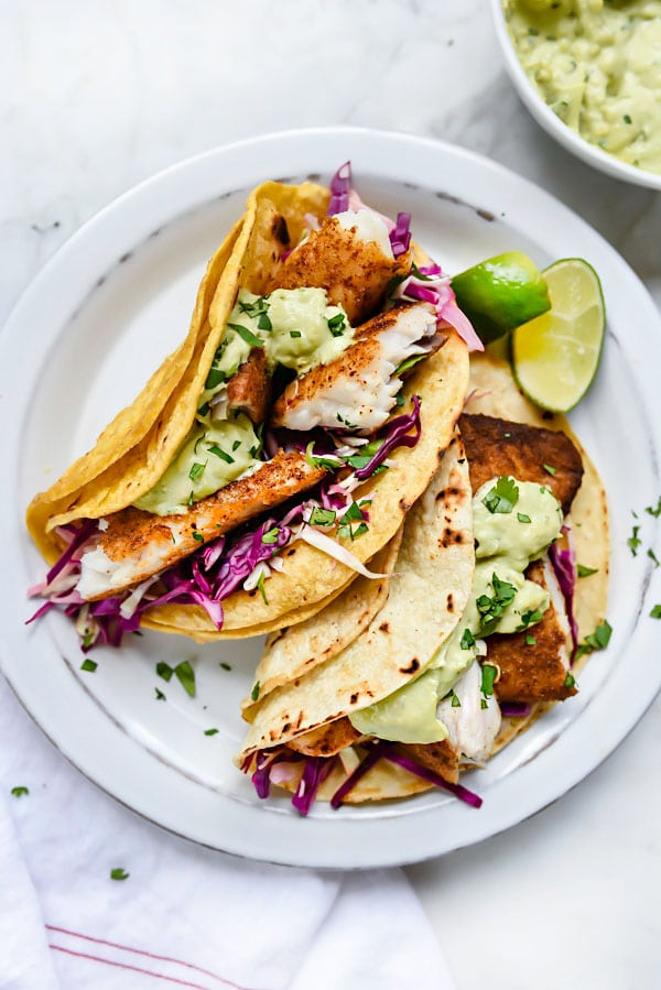 Blackened Fish Tacos with Creamy Avocado Sauce | foodiecrush.com