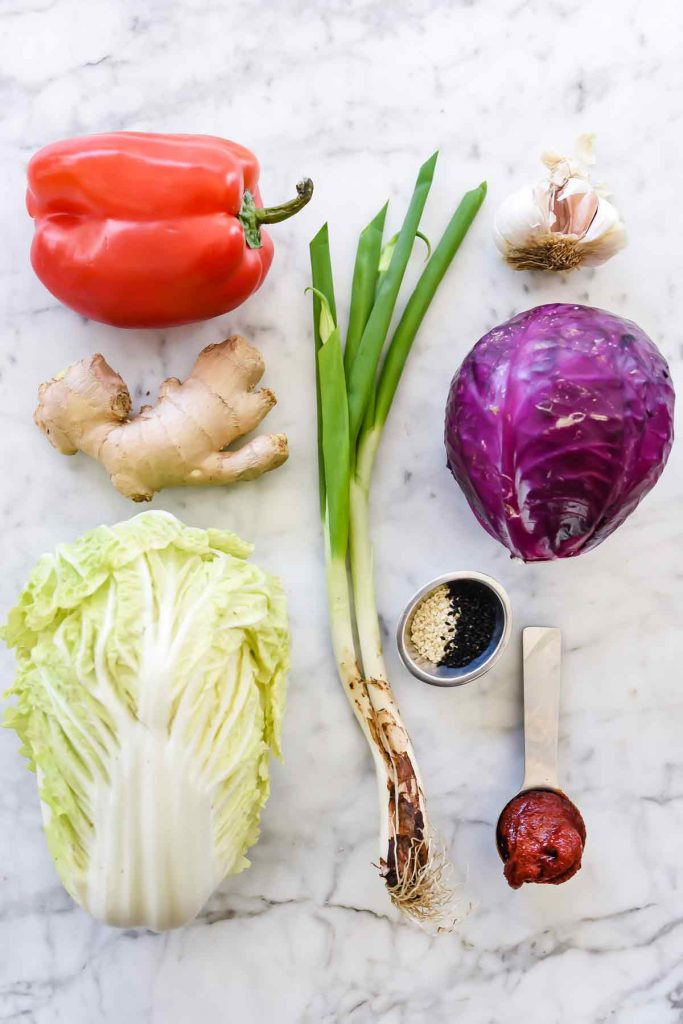Quick Korean Spicy Slaw with gochuchang, cabbages, ginger, red bell pepper | foodiecrush.com