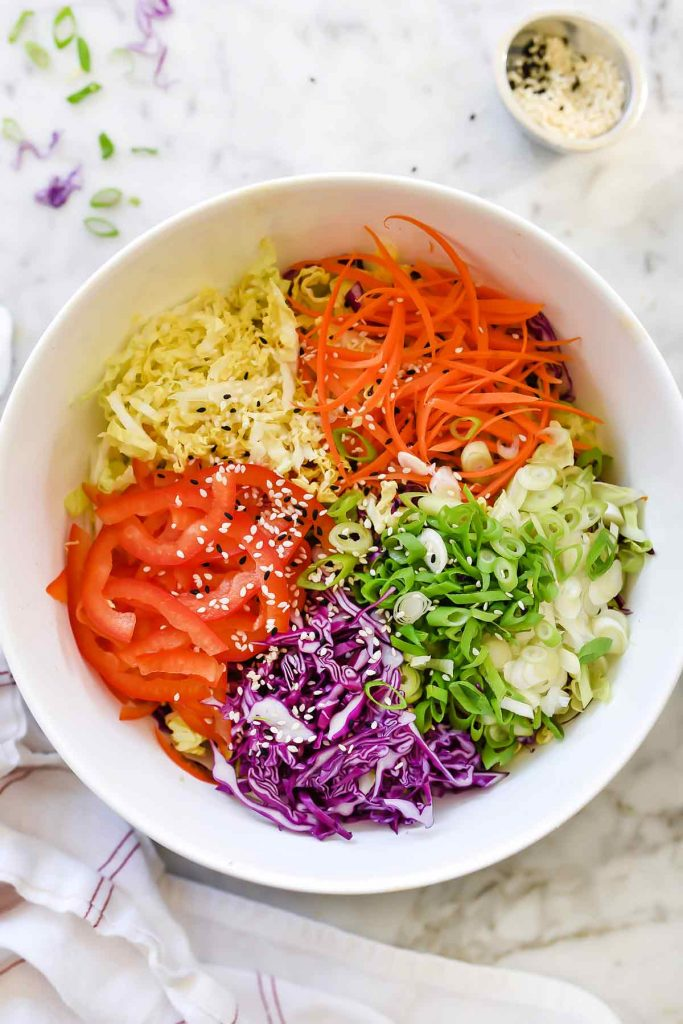 Quick Korean Spicy Slaw with cabbages, onion, ginger, red bell pepper | foodiecrush.com
