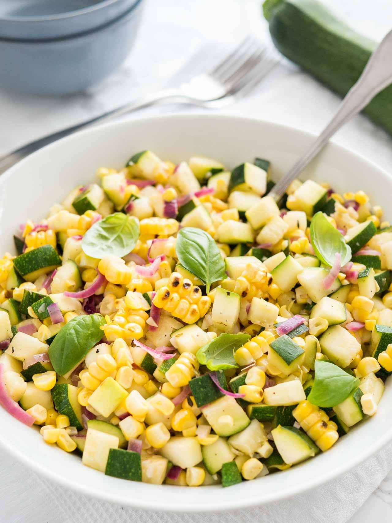 Roasted Corn Zucchini Salad from platedcravings.com on foodiecrush.com
