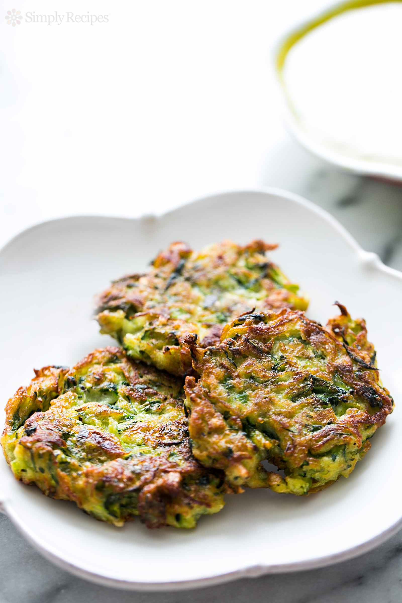 Zucchini Fritters from simplyrecipes.com on foodiecrush.com