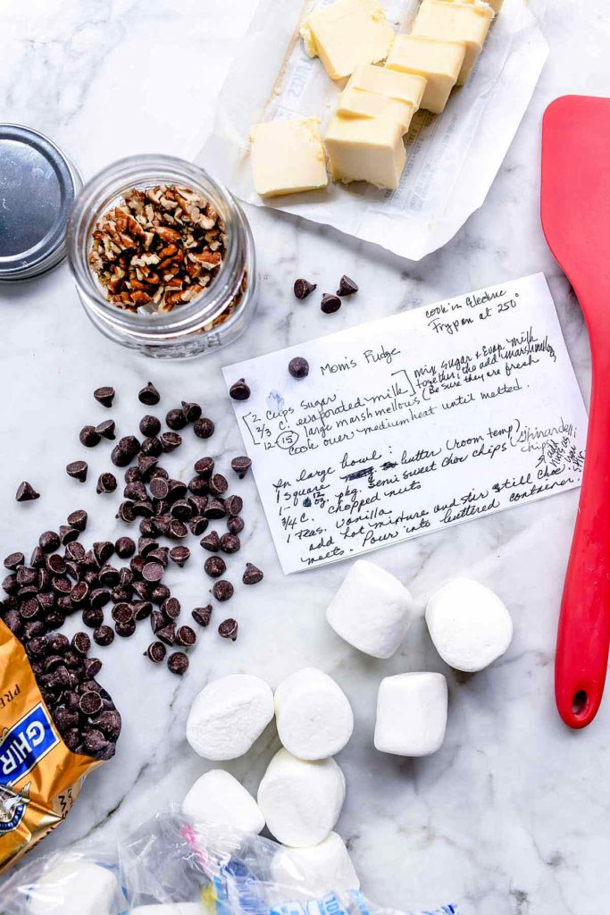 fudge recipe card on counter surrounded by fudge ingredients