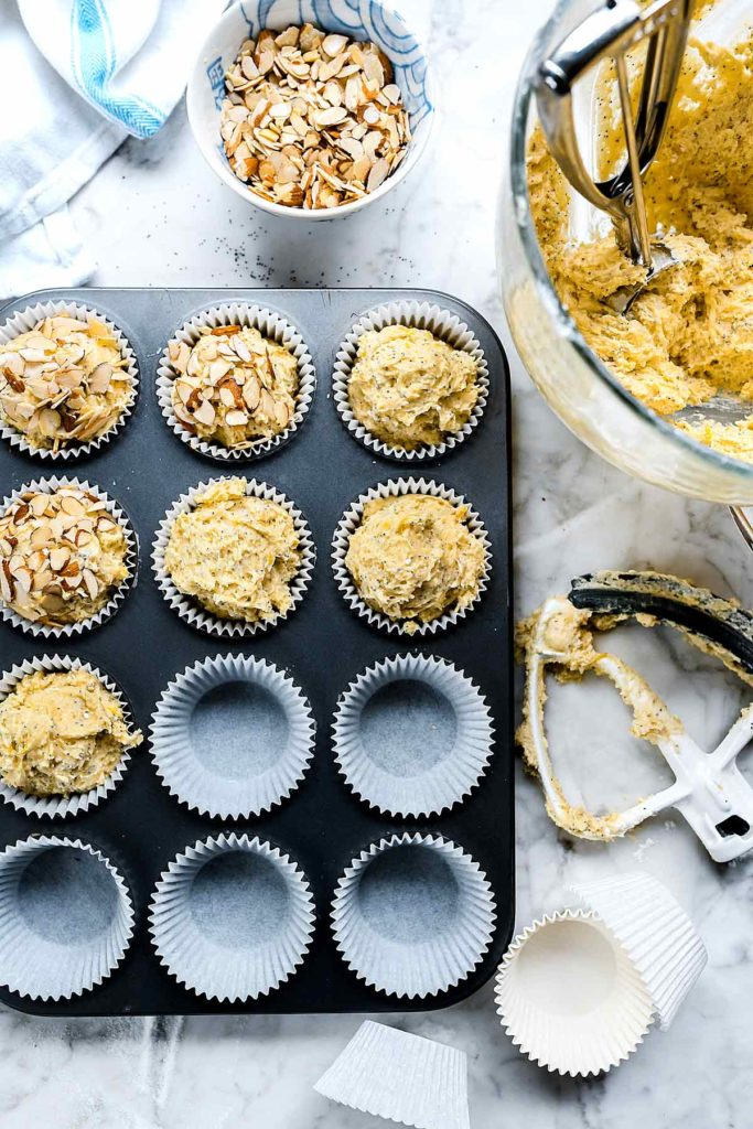 making lemon and almond poppy seed muffins