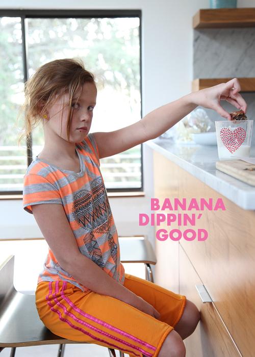 girl dipping slice of banana bread in milk