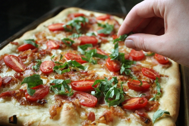 Pizza with Caramelized Onions, Bacon, Cherry Tomatoes and Fontina from Completely Delicious on foodiecrush.com