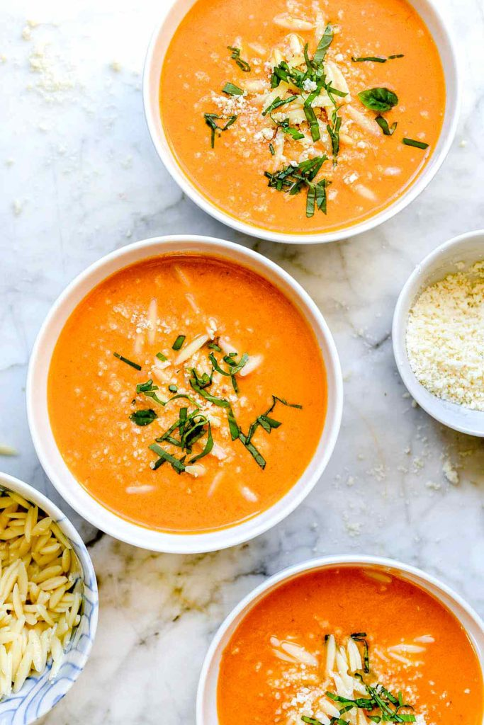 three bowls of tomato soup from scratch with orzo and parmesan