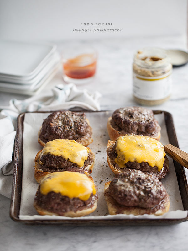 oven baked burgers topped with cheddar cheese