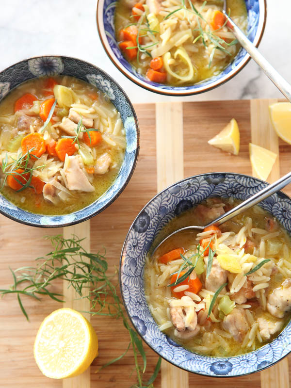 three bowls of Lemon Chicken Stew on wood cutting board