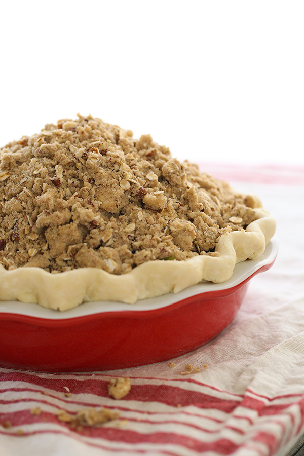 apple pie with crumb topping ready to be baked