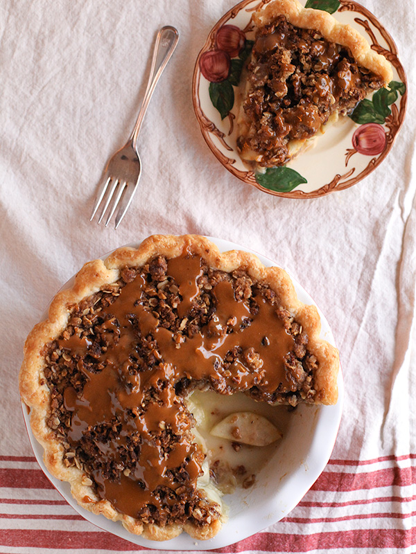 caramel apple pie with slice lying on plate next to it