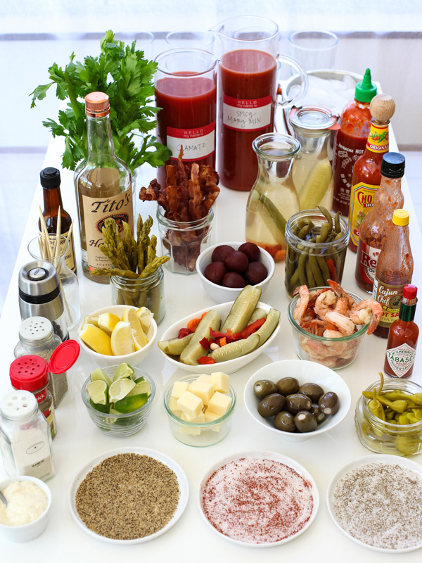 bloody mary ingredients laid out on table