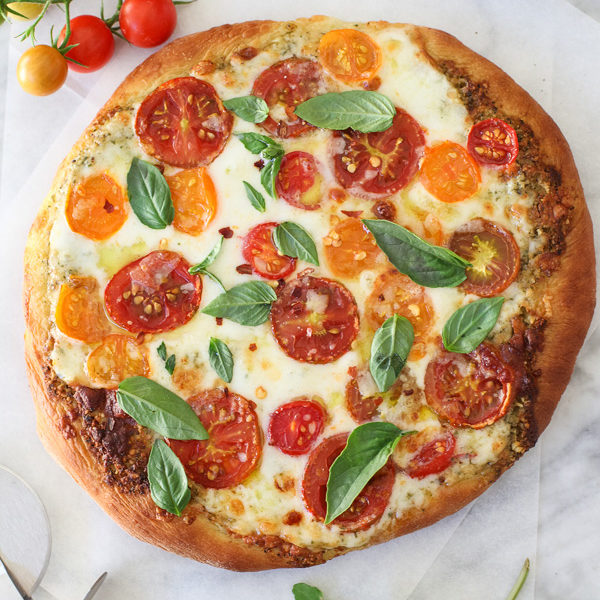 Pesto Pizza with Fresh Tomatoes and Mozzarella #recipe on foodiecrush.com