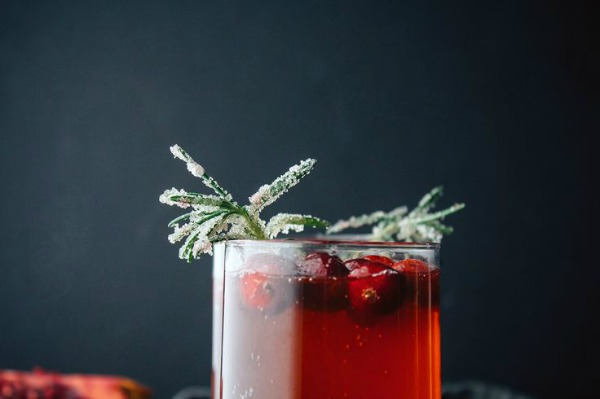 Pomegranate Cranberry Punch with Candied Rosemary from vegetarianventures.com on foodiecrush.com
