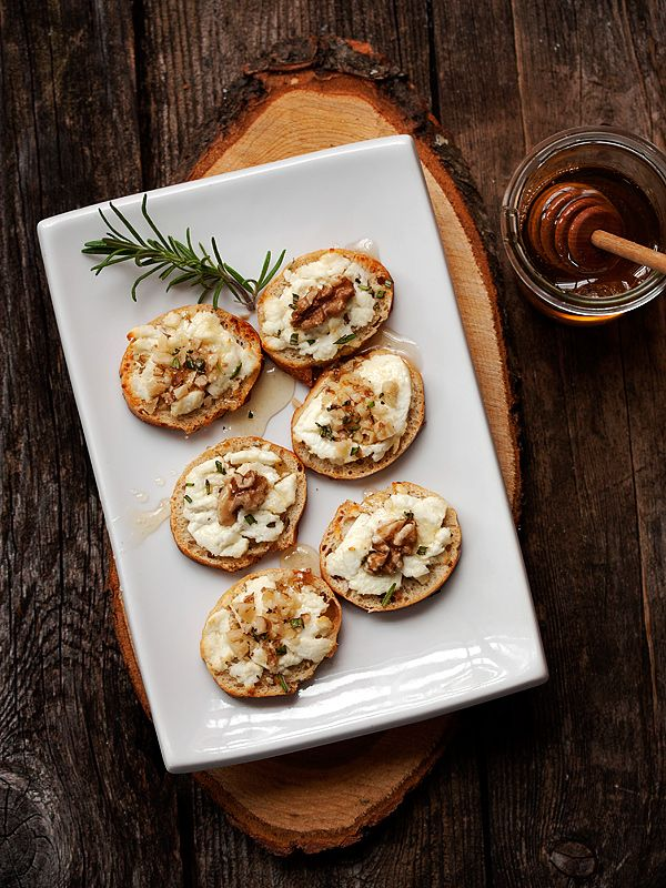 Warm Goat Cheese Toasts with Walnuts, Rosemary and Honey from seasonsandsuppers.ca on foodiecrush.com