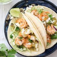 Shrimp Tacos with Garlic Avocado Crema on foodiecrush.com