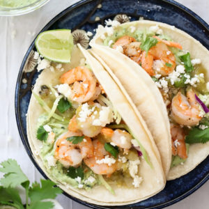 Shrimp Tacos with Garlic Avocado Crema on foodiecrush.com