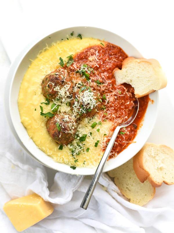 best turkey meatballs atop polenta with tomato sauce