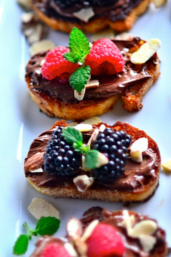 Nutella Berry Bruschetta from reluctantentertainer.com on foodiecrush.com