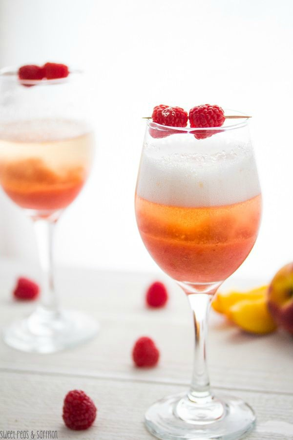 Peach & Raspberry Bellinis from sweetpeasandsaffron.com on foodiecrush.com