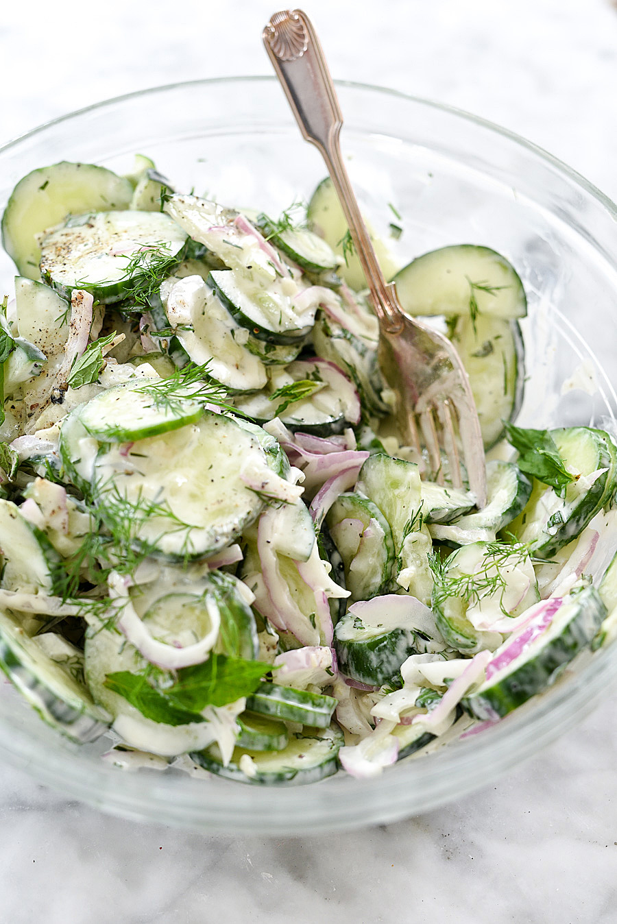 Creamy Yogurt Cucumber Salad Recipe | foodiecrush.com #tzatzikisauce #healthy #garlic