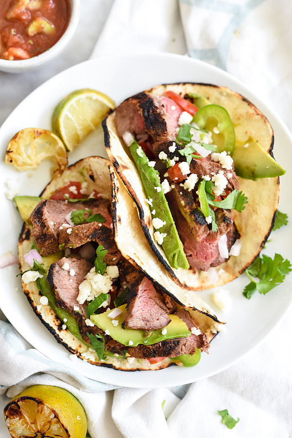 Grilled Steak Tacos marinated in a citrus adobo sauce for tons of flavor on foodiecrush.com
