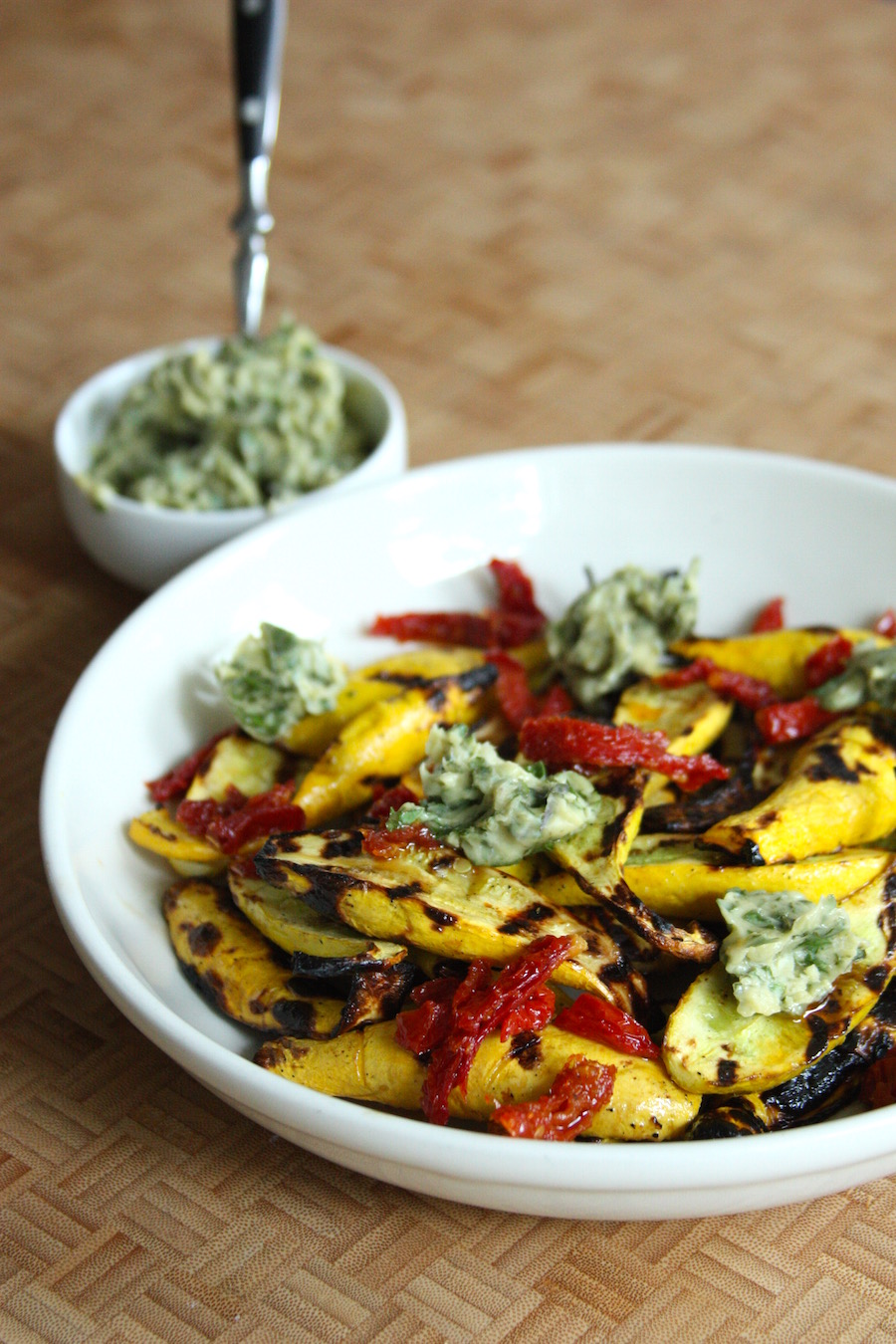 Grilled Summer Squash with Sun-Dried Tomatoes and Basil Ghee by Project Domestication | foodiecrush.com