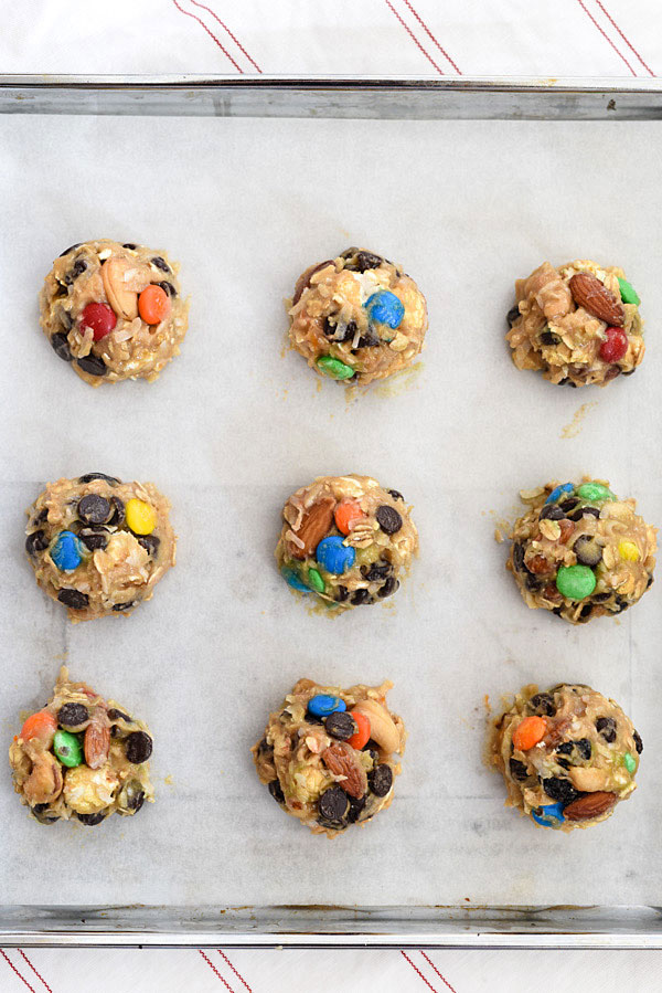Loaded Monster Cookies pack in all the flavors with whole wheat pastry flour, nuts, oatmeal, popcorn, and coconut. And don't forget the chocolate for a healthy twist on dessert | foodiecrush.com