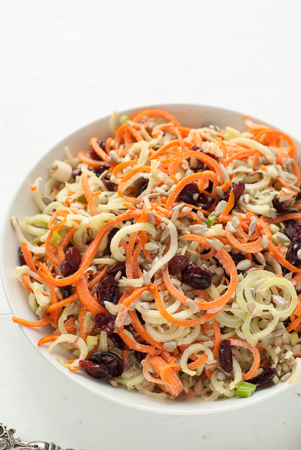 Spiralized Broccoli-Stem Carrot Slaw with Dried Cranberries from boulderlocavore.com on foodiecrush.com