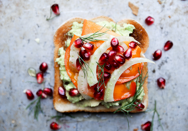 Avocado Toast with Persimmon, Pomegranate and Fennel from The Floating Kitchen on FoodieCrush.com