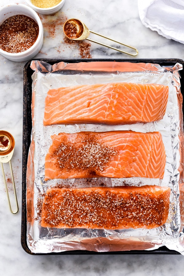 uncooked maple syrup salmon on baking tray