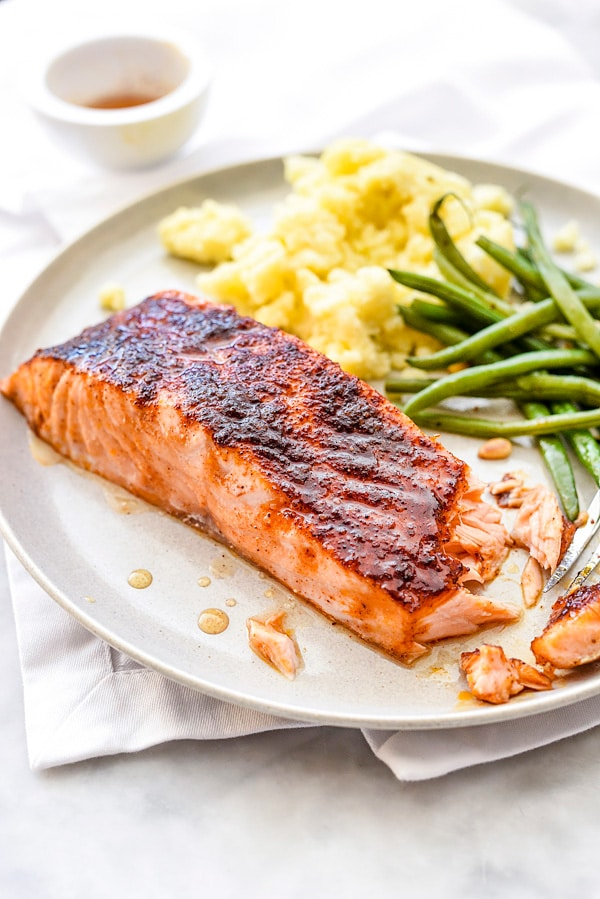maple glazed salmon fillet on plate with green beans and corn