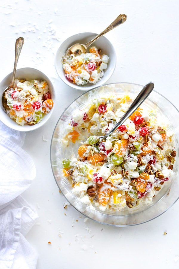 marshmallow fruit salad in large serving bowl and two smaller bowls