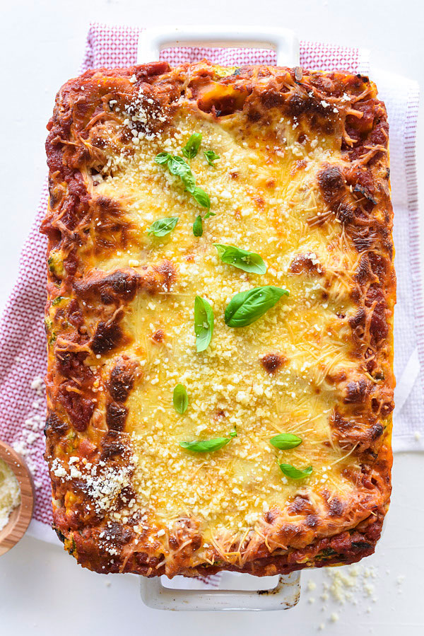 vegetarian lasagna with cottage cheese in white baking dish