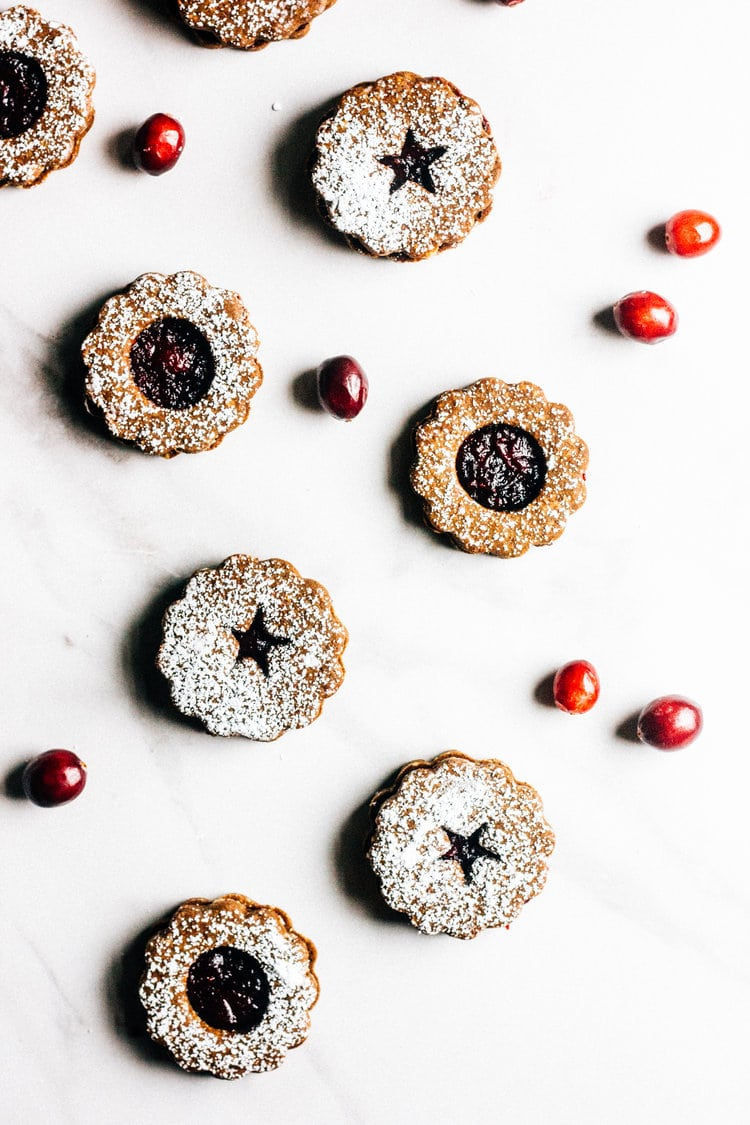 Gingerbread Cranberry Linzer Cookies from wholebiteblog.com on foodiecrush.com