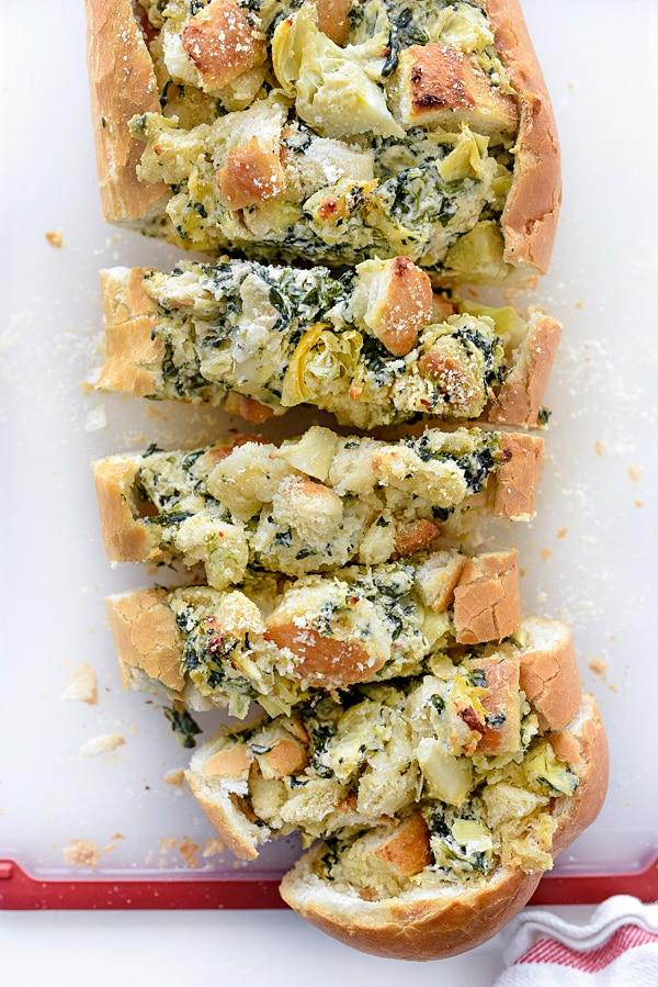 Spinach Artichoke Stuffed Bread | #stuffed #pullapart #dip #boat #creamcheese foodiecrush.com