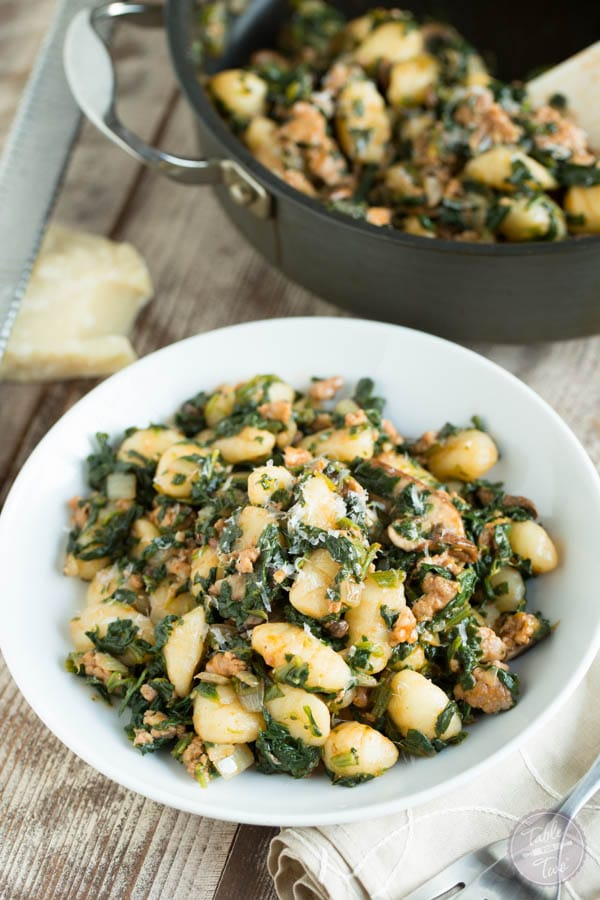 Spicy Sausage, Spinach, and Mushroom Gnocchi from tablefortwoblog.com on foodiecrush.com