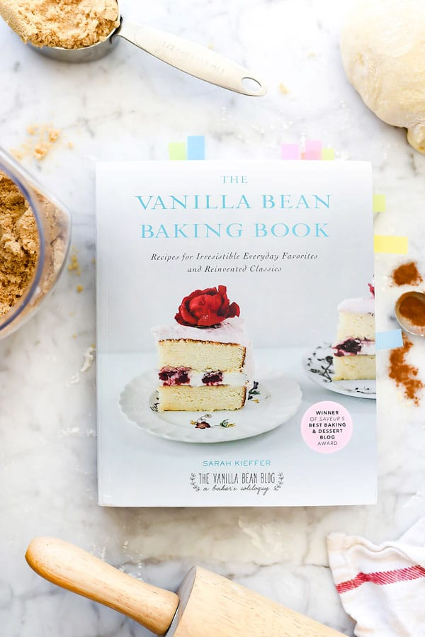 The Vanilla Bean Baking Book on counter next to cinnamon roll ingredients