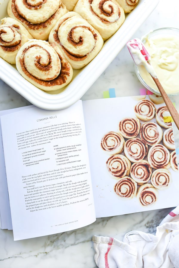 pan of easy cinnamon rolls next to cookbook