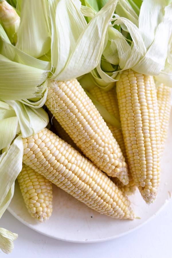Corn Cobs in the husk for grilled sweet corn