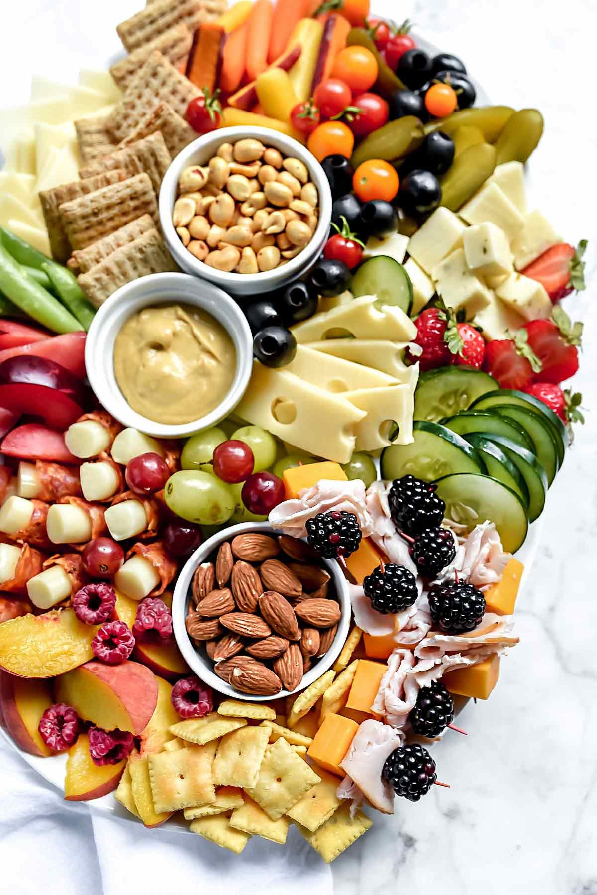 ... and won\u0027t make a mess and watch out for heavily flavored nuts with spices smoke or salts that could dominate the rest of the items on the platter.  sc 1 st  FoodieCrush & How to Make a Kid-Friendly Cheese Board Even Adults Will Love ...
